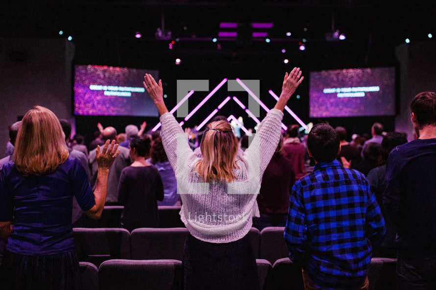 arms raised during a worship service