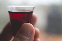 communion wine cup in hand