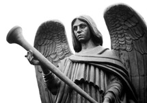An image of a bronze angel statue holding a trumpet ready to sound a trumpet as mentioned in the book of Revelation.