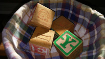 A group of Alphabet blocks for home schooling, education and learning for young children in a school, home or primary school environment.  Creative Visuals for helping children learn their alphabet, spelling, grammar and learning how to read and write.