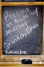 "A chalkboard complete with chialk and eraser with the words ""Blessed are those with amazing Grand Children"" and the verse Romans 10:15 referencing the verse ""And how can anyone preach unless they are sent? As it is written: ""How beautiful are the feet of those who bring good news!"""" Children who are raised in a Christian home to grow up and share the gospel with others is the hope of every Christian parent. They are blessed when their children grow up and fulfill the calling of God in their lives including going out and spreading the gospel to all nations."