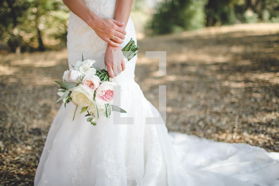 Bride's hands holding a bouquet.