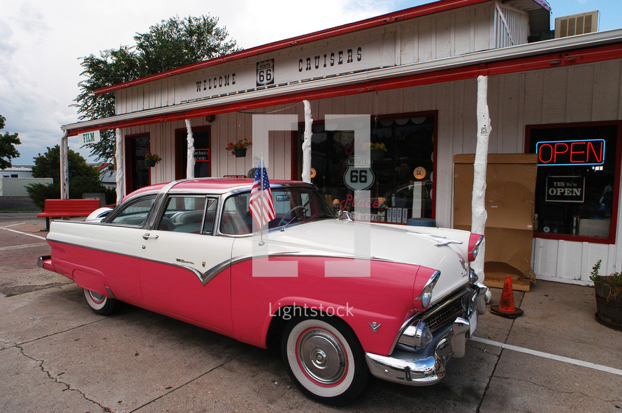 old car in front of a route 66 service station