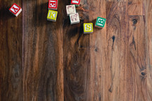 alphabet wooden blocks on a wood floor