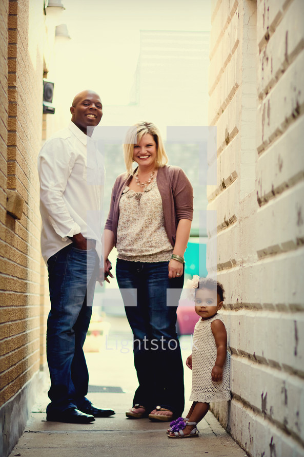 family standing together in a hallway