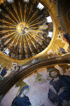 Golden mosaic covered rotunda featuring Christ Jesus and the disciples