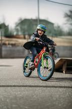 child riding a bike at a park