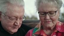 elderly couple praying together