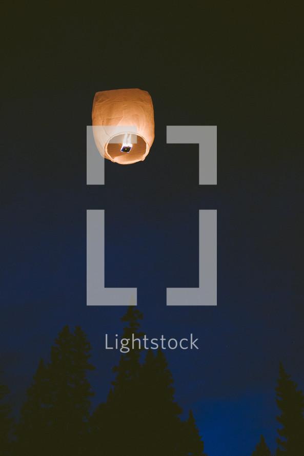 paper lantern in the night sky