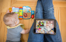 a mother, an infant, and an iPad