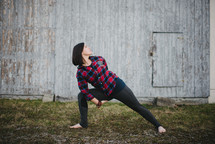 a woman doing yoga outdoors