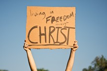 """Living in Freedom Through Christ"" sign"
