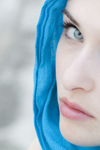 Lady Macbeth; woman with blue scarf looking toward camera.