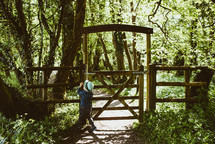a child standing by a gate