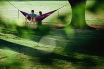 couple sitting in a hammock