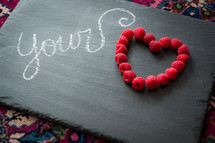 word your in chalk and raspberries in the shape of a heart