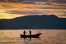 fishermen fishing at sunset