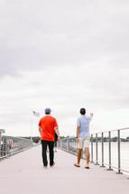 men walking on a pier