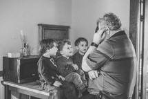children listening to granddad