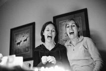 two women singing Happy Birthday