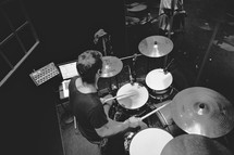 A man playing a drumset