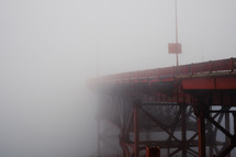 morning fog and a red bridge