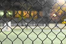 chain link fence and baseball stadium