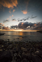 sunset and rocky shore