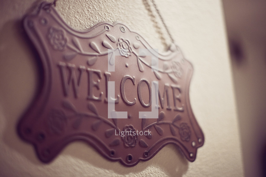 welcome sign on wall
