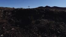 cross in a desert desert landscape