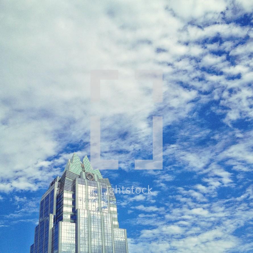 clouds above the top of a sky scraper