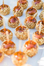 Caramel apple nuts on a stick