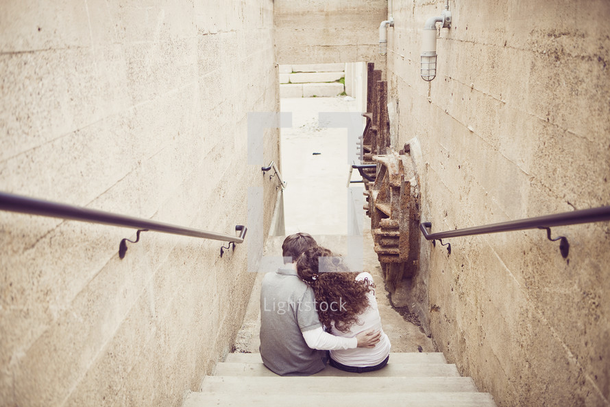 woman, man - embracing on stairwell, old buildings