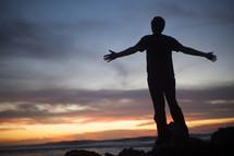 Man standing by ocean