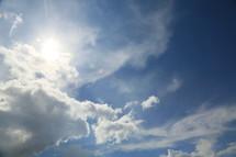 sunlight through wispy clouds
