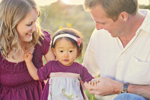 Couple with adopted baby girl