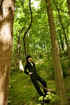 Man resting on a tree limb