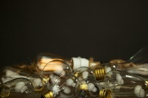 A cluster of lightbulbs isolated on black