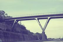 A high bridge over a highway.