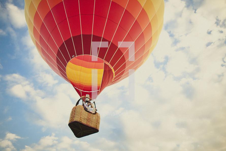 A couple riding in a hot air balloon