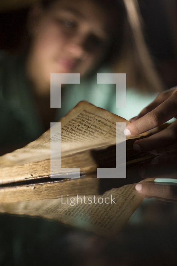 Teen girl reading Bible