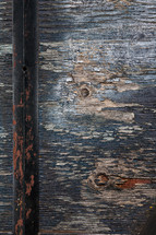 Wood texture and rusted pole