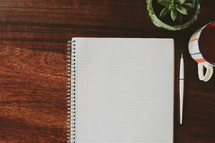blank paper in a spiral notebook