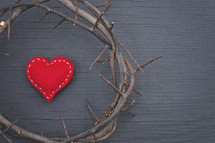 crown of thorns and red felt heart