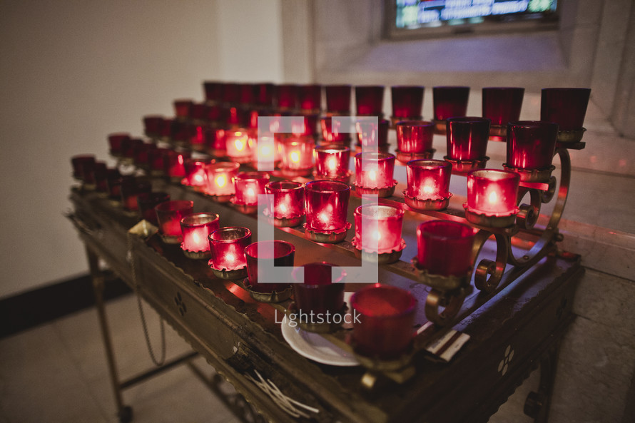 Tiered rows of votive candles