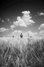 Jesus walking in a field