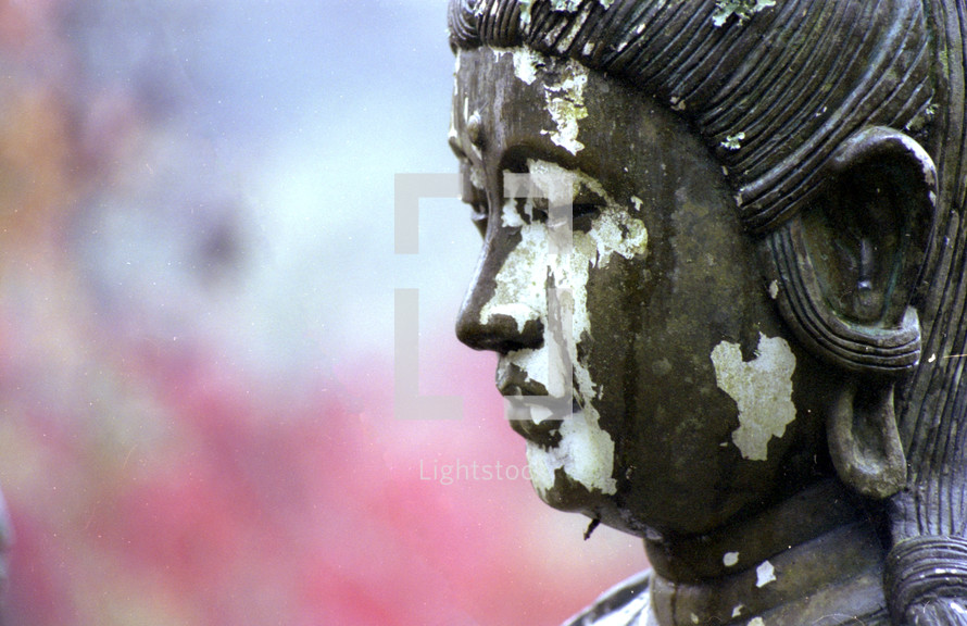 Chipped Japanese statue