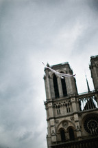 A dove flying in front of the Notre Dame Cathedral