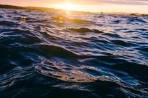 sunset over choppy water