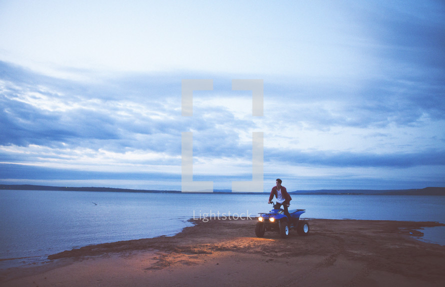 four wheeler driving on a beach